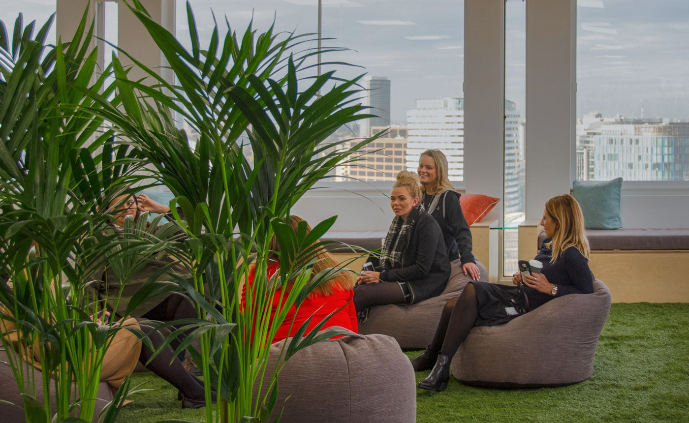 Team at InfoTrack using the nature-inspired garden breakout area within their office design