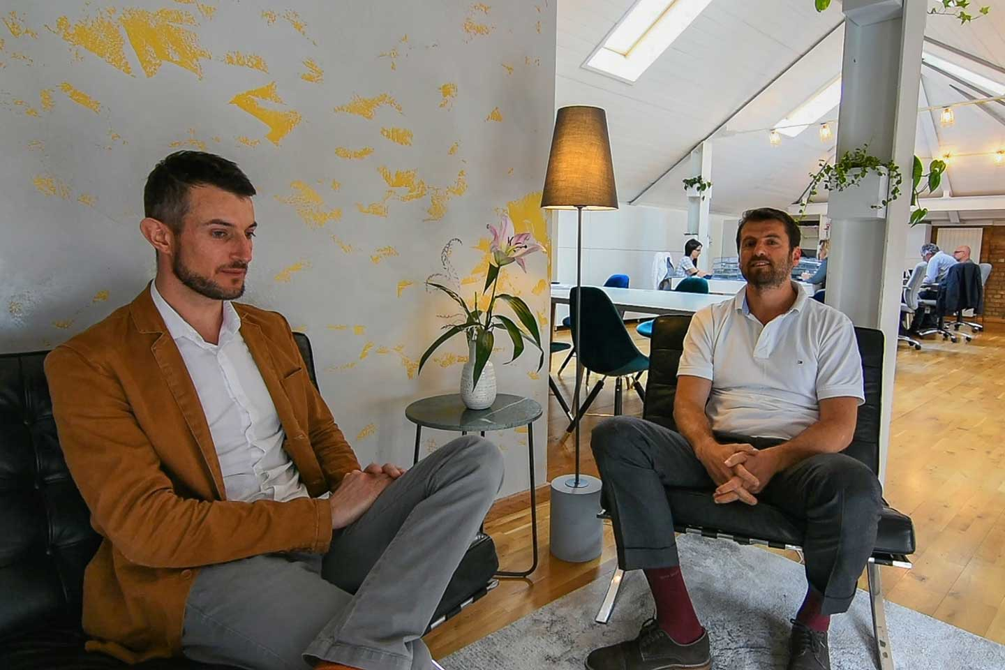 Our founder Marc sitting have an interview with the happy client at Avalon founder Miroslav Bogdantsaliev in the new office design reception area