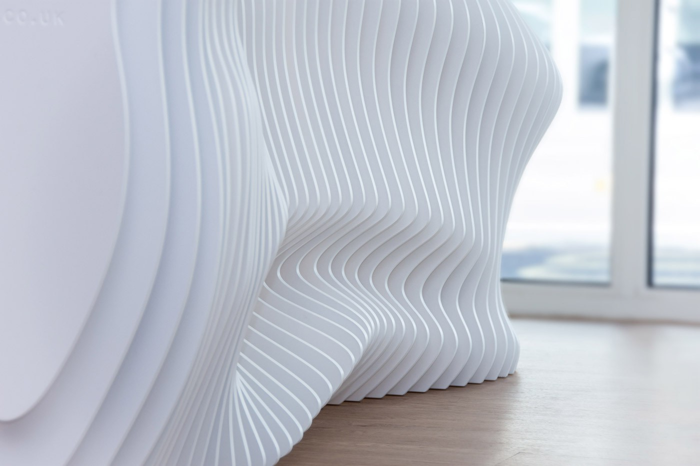 A close up photo of the detail in the bespoke reception desk at the Banning Dental Group Brentford office