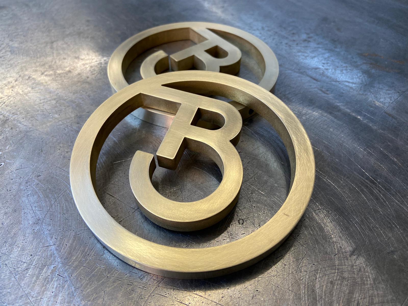 Brass logos for bespoke branding design element