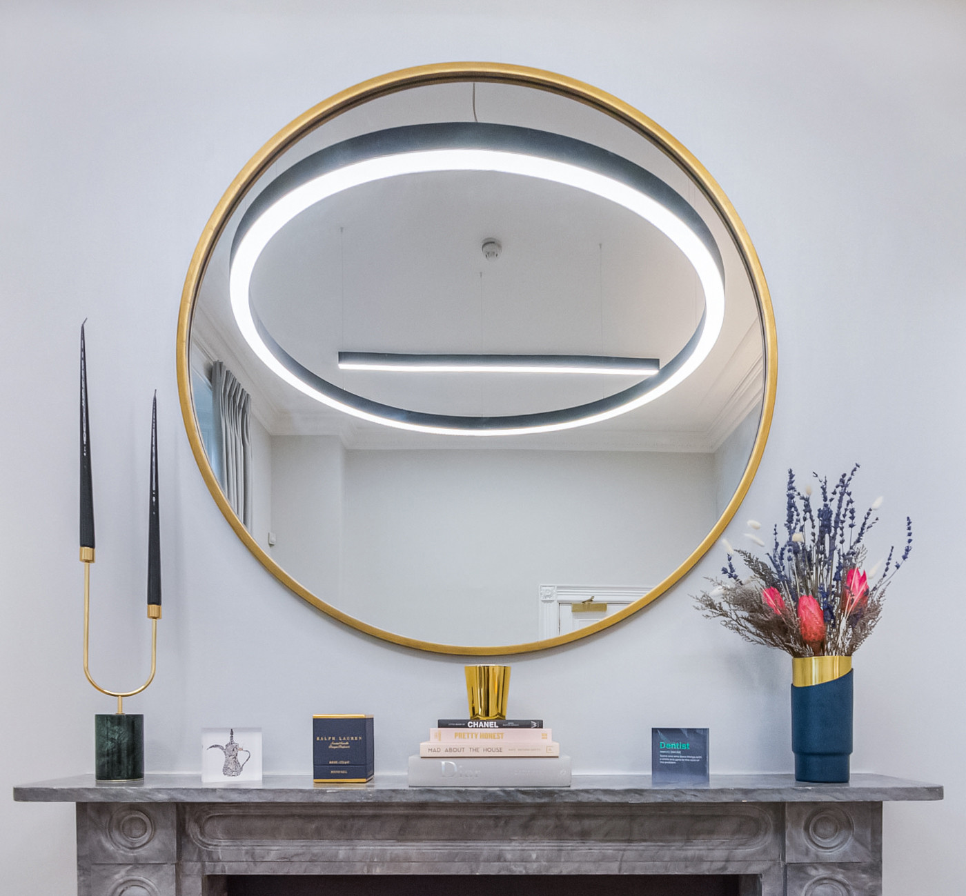 Premium design details brass circular mirror and a hanging halo light at the luxury dental clinic in harley street