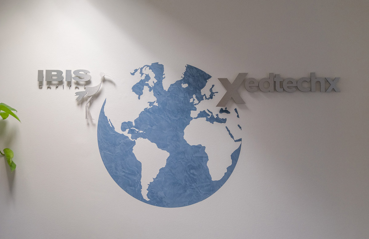Imprinted wall art of a globe representing the international aspect to the Ibis Capital company