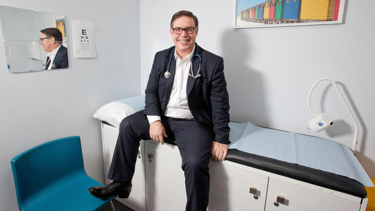 Our client Seth Rankin sitting on the patient chair at one of the London Doctors Clinics
