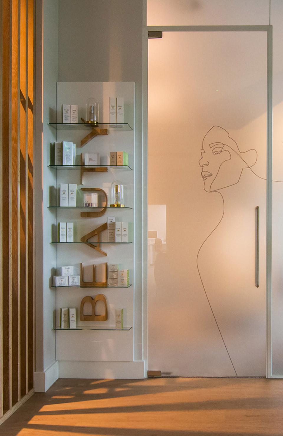 Bespoke branding merchandise rack at Banning Dental Group captured in ambient lighting