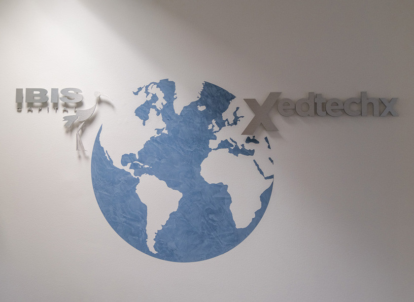 Bespoke branding logo design hand painted onto the wall of a textured coloured globe and silver plate lettering