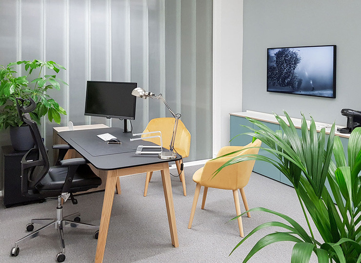 Commercial interior design creating personal spaces like this private desk area for Ben Keirle from 1Account