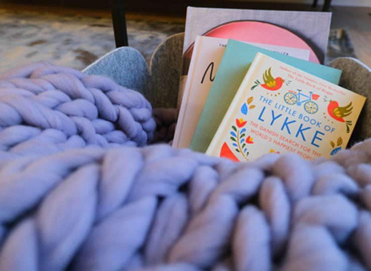 Detail is a key element in design which we always make sure is in line with the company branding, this image reveals scandanavian books with a cosy purple woolen blanket for a homely touch to dental office design