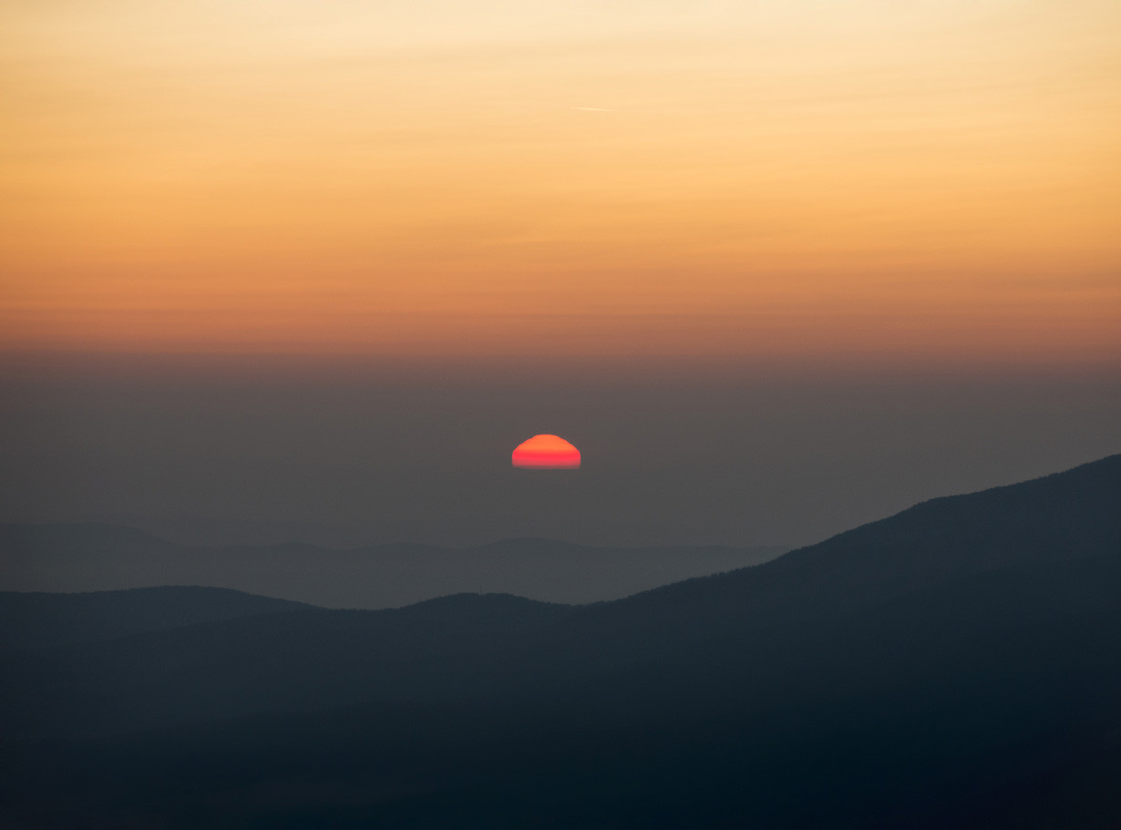 Our inspiration for much of our commercial interior design comes from nature, this picture of a sunset reveals the perfect balance of ombre yellow and orange colours behind the silhouettes of the mountain range