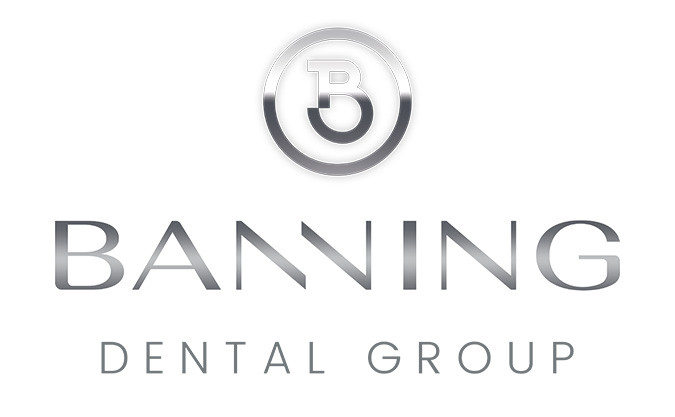 The Banning Dental Group company logo in silvery grey with the letter 'B' inside a circle